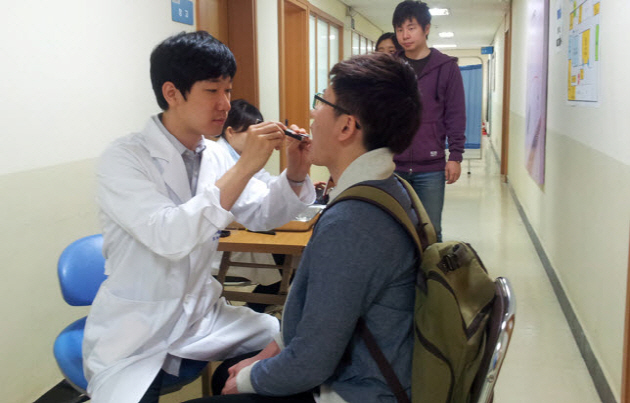 A student is taking a regular dental check-up at SNU Health Center